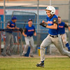 Newton Post 20's Joe Stone heads home for the winning run as teammates rush out of the dugout. Newton came from behind to defeat Effingham Post 120 6-5 in game one of their doubleheader.