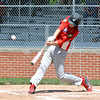 Effingham Post 120's Drew Gibson hits an RBI single against Robinson Post 69 at Paul Smith Field.