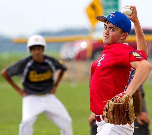 Shelby County's Hayden Francisco cocks back prior to his release during a game against Danville Post 210.