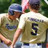 Teutopolis Post 924's Carson Hartke flashes a smile as he is greeeted by pitcher Collin Funneman after hitting the walkoff single in the bottom of the eighth to defeat Rantoul Post 287 1-0 at the Firecracker Classic in Mattoon.