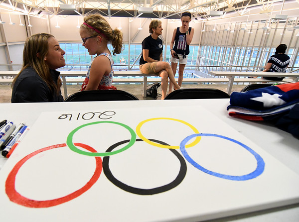 Olympic Trial qualifier Avery Braunecker(left) receives well wishes from Cecelia Passalacqua (center left), 6, of Effingham at the Richard E. Workman Sports and Wellness Complex. Braunecker had a send off ceremony in advance of her leaving for the trials in Omaha, Neb.<br /> Chet Piotrowski Jr./Piotrowski Studios