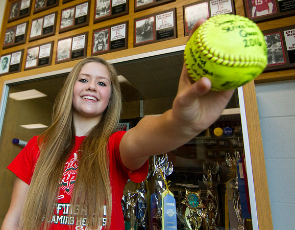 Soon-to-be Effingham junior Aly Armstrong holds the ball that she threw against Rantoul May 25 when she broke the single-season strikeout record of 187. She would go on to finish the year with 210.