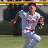 Toledo left fielder Kaleb French chases down a flyball during a game against Macon County Post 105 in Mattoon.