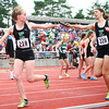 6-1-13<br /> Girls state track and field<br /> Sarah Wagner passes off to Brittany Neeley during the 3200 meter relay.<br /> KT photo | Kelly Lafferty