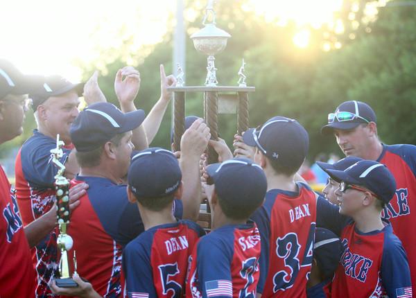 6-26-14<br /> Kasey Championship<br /> McPike celebrates with the trophy after winning the Kasey championship.<br /> Kelly Lafferty | Kokomo Tribune