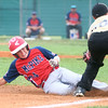 6-24-14<br /> McPike vs. Mike's Pizza<br /> McPike's Parker Dean slides safely to third base before Mike's Pizza's Palmer Harrell can get him out.<br /> Kelly Lafferty | Kokomo Tribune