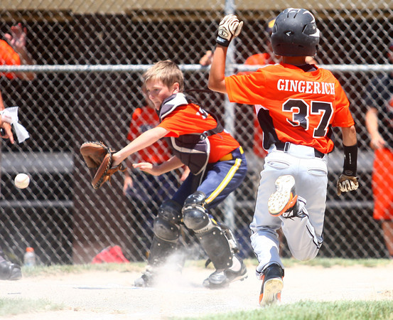 6-21-14<br /> David A. Kasey tournament<br /> Weston Gingrich of Burger King gets to home safely before Kendall Lanning of White's Meat Market tries to get him out.<br /> Kelly Lafferty   Kokomo Tribune