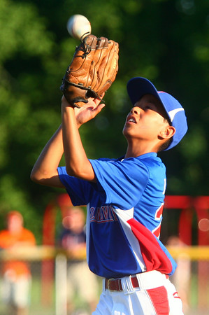 6-26-14<br /> Kasey Championship<br /> Hollingsworth's Nathaniel Liddell makes a catch for an out.<br /> Kelly Lafferty | Kokomo Tribune