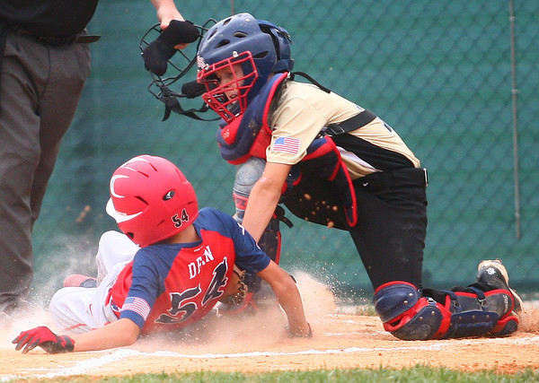 6-24-14<br /> McPike vs. Mike's Pizza<br /> McPike's Mitchell Dean gets to home safely and scores the team's first run before Mike's Pizza's catcher can get him out.<br /> Kelly Lafferty | Kokomo Tribune