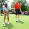 6-16-14   --- The Ball State Alumni Golf outing at the Kokomo Country Club. Mike Fleck(BSU Golf Coach) and Brad Edmondson(Executive Director of the Cardinal Varsity Club) on the practice putting green.  --<br />   Tim Bath | Kokomo Tribune