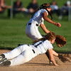 5-30-14<br /> Western Sectional softball<br /> Western's Evie Glover and Brook Strunk lunge for the ball.<br /> Kelly Lafferty | Kokomo Tribune