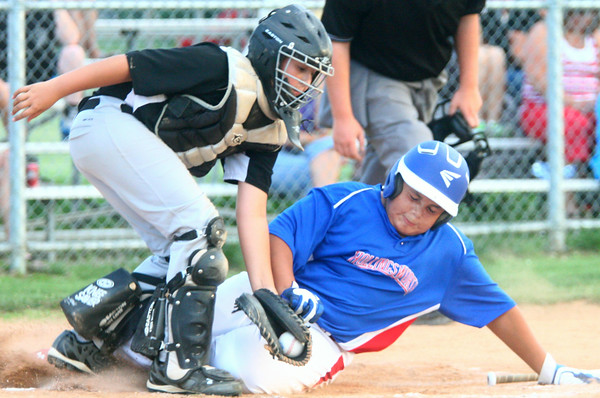 6-25-14<br /> Hollingsworth Lumber vs. Martin Brothers<br /> Coby Tuggle of Hollingsworth Lumber slides into home safely before Luke Dunlap of Martin Brothers can get him out.<br /> Kelly Lafferty | Kokomo Tribune