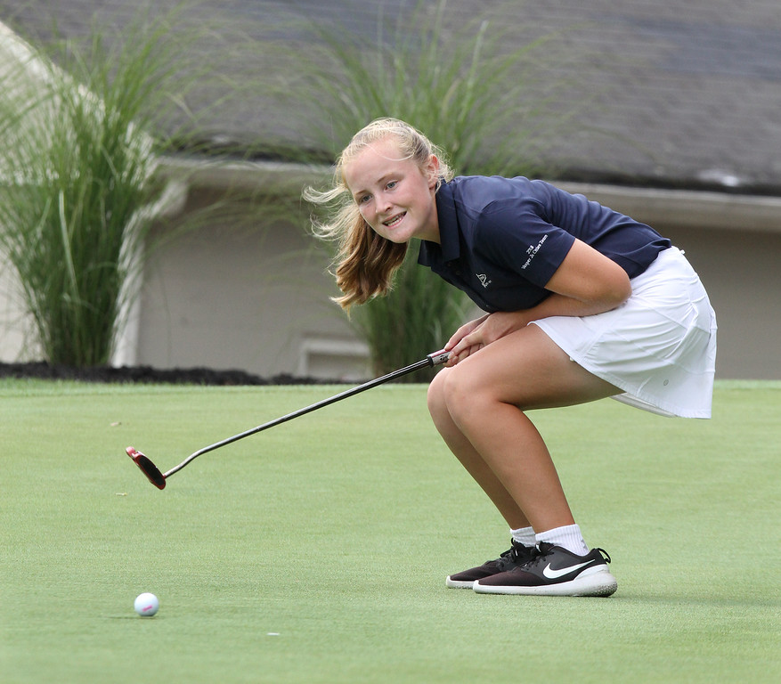 . Lowell Junior City Golf Tournament at Mount Pleasant. Girls winner Morgan Smith watches winning putt go in on 18. (SUN/Julia Malakie)