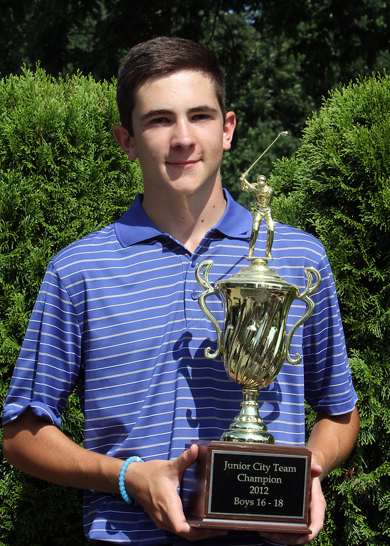 . Lowell Junior City Golf Tournament at Mount Pleasant. Boys winner Mikey Yfantopoulos, holding a standin trophy, the team trophy. (SUN/Julia Malakie)