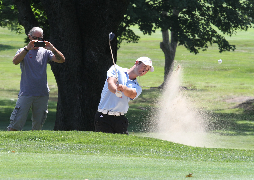 . Lowell Junior City Golf Tournament at Mount Pleasant. Trevor Green, who tied for second, hits out of a bunker on 18. (SUN/Julia Malakie)