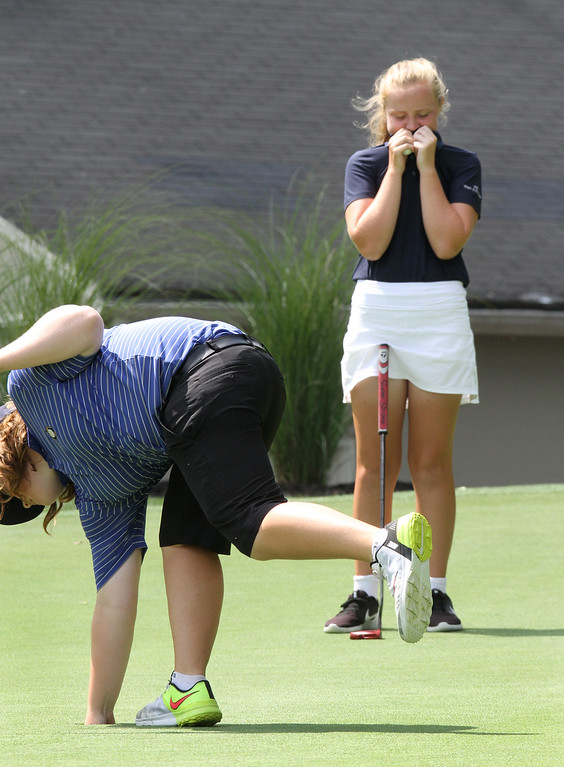 . Lowell Junior City Golf Tournament at Mount Pleasant. Eventual winner Morgan Smith, rear, gets ready to putt on 18 as her sister Molly Smith finishes the hole. (SUN/Julia Malakie)