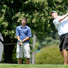 Mitchell Smith watches his tee shot off the 7th tee at Grandview as Zach Harvey looks on during the Madison County Junior Golf Tour on Wednesday.