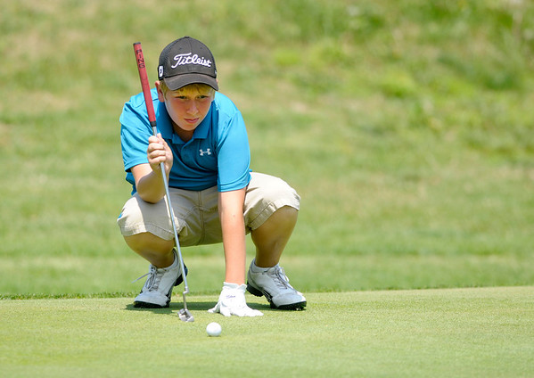 Garrett Nealon checks the break of his putt on the first green at Grandview during the Madison County Junior Golf Tour on Wednesday.