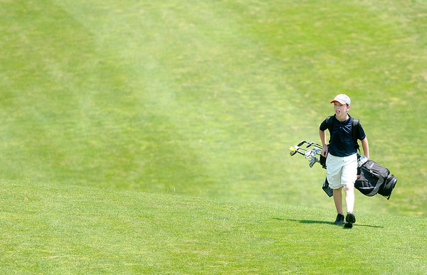Riley George walks down the first fairway at Grandview during the Madison County Junior Golf Tour on Wednesday.