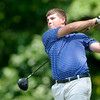 Zach Harvey watches his tee shot off the 8th tee at Grandview during the Madison County Junior Golf Tour on Wednesday.