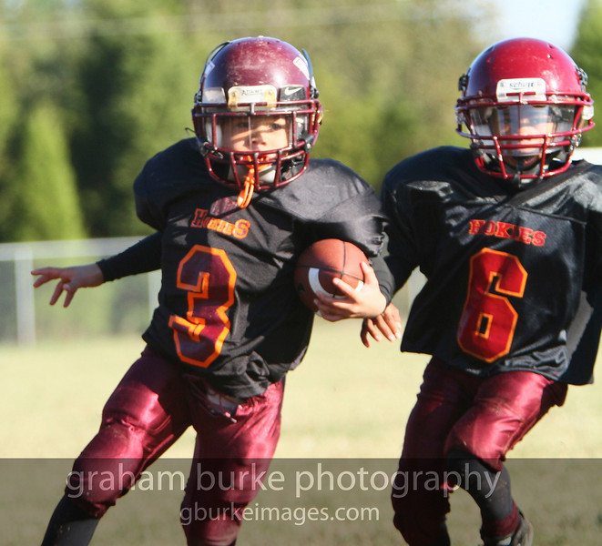 The Junior Hokies of Charlotte NC in action during their league's semi-final win.