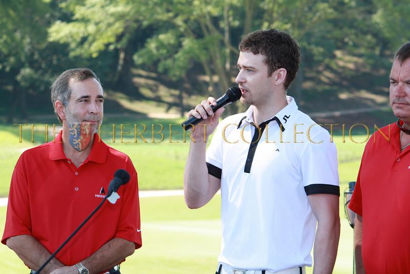 Paul Harless looks on as Justin Timberlake speaks