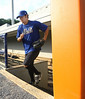 A Mets pitcher comes out of the dugout for practice at Hunter Wright Stadium. Photo by Erica Yoon