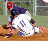 JC Cards infielder Luis Mateo, #4, looks to put the tag on a sliding K-Met #11, Evan Leblanc, at second base. Photo by ned Jilton II