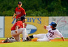 Elizabethton Twins shortstop Daniel Santana tags out Kingsport Mets second baseman Justin Schafer as he is caught stealing in the first inning during Tuesday's matchup at Hunter Wright Stadium. Photo by Kris Wilson - kswilson@timesnews.net