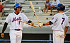 Kingsport Mets right fielder Javier Rodriguez gets congratulations by shortstop Brandon Brown after scoring the K-Mets' lone run on a sacrifice fly during Thursday night's matchup against the Bluefield Orioles at Hunter Wright Stadium. Photo by Kris Wilson - kswilson@timesnews.net