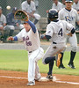 #4 for Princeton arrives at first ahead of the throw being fielded by Kmets #26, Jeyckol De Leon. Photo by Ned Jilton II