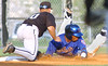 Kmets #4, Bradley Marquez, is tagged out at third after trying to pick up two bases from first on a single. Photo by Ned JIlton II