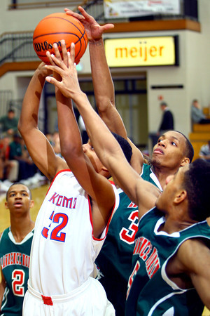 12-27-13   ---  Kokomo HS vs Lawrence North HS Boys Basketball. With Jordan Matthews shooting Lawrence North's Perry Poindexter, Jr. and Quadre Lollis.<br /> <br />   KT photo | Tim Bath