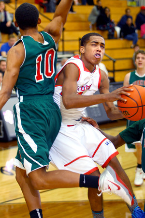 12-27-13   ---  Kokomo HS vs Lawrence North HS Boys Basketball. Mykel Coxgoing in for a shot and being fouled by Marcus Avery Jr. during a last minute rally that was too little too late.<br /> <br />   KT photo | Tim Bath