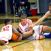12-27-13   ---  Kokomo HS vs Lawrence North HS Boys Basketball. Kokomo being aggressive in the last minutes of the game brought about a loose ball with Kokomo's Jordan Matthews and Erik Bowen pulling the ball from Larence North's Jaylen McKay.<br /> <br />   KT photo | Tim Bath