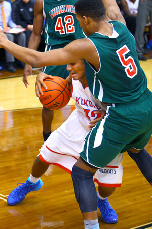 12-27-13   ---  Kokomo HS vs Lawrence North HS Boys Basketball. Jordan Matthews pushing his way in with Quadre Lollis not moving much in the 4th.<br /> <br />   KT photo | Tim Bath