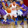 12-20-13   ---  Kokomo HS vs Marion HS boys basketball  -- Kokomo's Jeron Gray being pressed as he brings the ball down the court. Marion's James Blackmon and Reggie Jones putting that pressure on.<br />   KT photo | Tim Bath