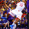 12-20-13   ---  Kokomo HS vs Marion HS boys basketball -- Kokomo's Jaron Gray shooting with Marions James Blackmon undercutting him.<br />   KT photo | Tim Bath