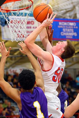 12-20-13   ---  Kokomo HS vs Marion HS boys basketball  --- Erik Bowen putting the ball up in the second quarter.<br />   KT photo   Tim Bath