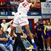 12-20-13   ---  Kokomo HS vs Marion HS boys basketball --  Kokomo's Demarius Warren rebounding in the 3rd quarter.<br />   KT photo | Tim Bath