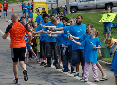 Volunteers offer water and snacks on Bronson Blvd. in front of the Girl Scout Building near Maple Street, just beyond the halfway point during the Kalamazoo Marathon on May 6, 2012.  (Bradley S. Pines for John Lacko Photography) CONTACT: bspines@gmail.com
