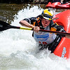 """Dane Jackson of Rock Island, TN, does his C-1 freestyle routine on Sunday during the Lyons Outdoor Games.<br /> For more photos of freestyle kayaking, go to    <a href=""""http://www.dailycamera.com"""">http://www.dailycamera.com</a>.<br /> Cliff Grassmick / June 10, 2012"""