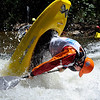 """Bryan Kirk of Fayetteville, WV, does his freestyle routine on Sunday during the Lyons Outdoor Games.<br /> For more photos of freestyle kayaking, go to    <a href=""""http://www.dailycamera.com"""">http://www.dailycamera.com</a>.<br /> Cliff Grassmick / June 10, 2012"""