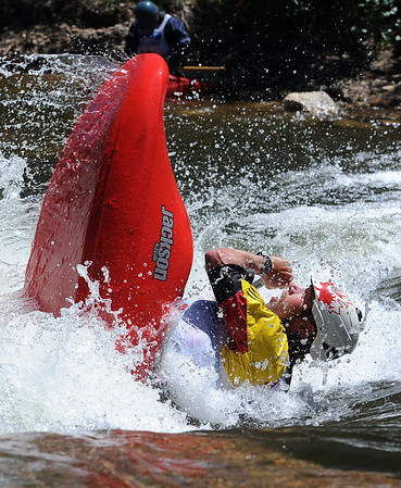 """Nick Troutman of Ottawa, Canada, does his freestyle routine on Sunday during the Lyons Outdoor Games.<br /> For more photos of freestyle kayaking, go to    <a href=""""http://www.dailycamera.com"""">http://www.dailycamera.com</a>.<br /> Cliff Grassmick / June 10, 2012"""