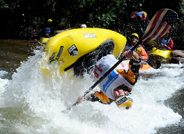 """Dane Jackson of Rock Island, TN, does his  freestyle routine on Sunday during the Lyons Outdoor Games.<br /> For more photos of freestyle kayaking, go to    <a href=""""http://www.dailycamera.com"""">http://www.dailycamera.com</a>.<br /> Cliff Grassmick / June 10, 2012"""