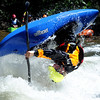 """Adam Chappell of Stittsville, Ontario, Canada, does his freestyle routine on Sunday during the Lyons Outdoor Games.<br /> For more photos of freestyle kayaking, go to    <a href=""""http://www.dailycamera.com"""">http://www.dailycamera.com</a>.<br /> Cliff Grassmick / June 10, 2012"""