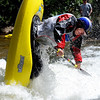 """Clay Wright of Walling, TN, does his freestyle routine on Sunday during the Lyons Outdoor Games.<br /> For more photos of freestyle kayaking, go to    <a href=""""http://www.dailycamera.com"""">http://www.dailycamera.com</a>.<br /> Cliff Grassmick / June 10, 2012"""