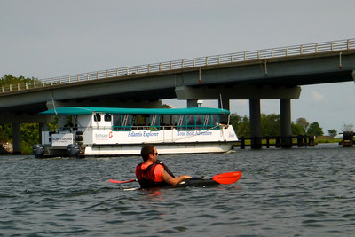 The Aquarium tourboat goes by. Kayaking down the Peconic Riverfront.