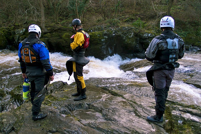 Wyedean Canoe Club members recce the Serpents Tail for safety near Llangollen before attempting a run.