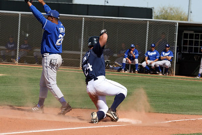 Keith Conlon slides into 3rd base with a triple against the Royals.
